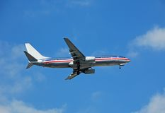 Boeing 737 passenger jet. Modern jet airplane approaching airport stock photos
