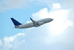 Boeing 737 takeoff. Passenger jet climbing in flight Stock Photo