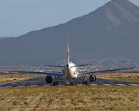 Boeing 737 takeoff. Boeing 737 charter taking off from small airport Stock Images