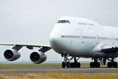 Boeing 747 jet airliner in white. Boeing 747 jet airliner on the runway Stock Images