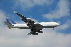 Boeing 747 jumbo jet. Large heavy passenger jet airplane in flight stock photos
