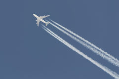 Boeing 747 leaving contrail. Boeing 747 at high altitude leaving contrail in the sky royalty free stock images