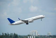 Boeing 757 jet in flight. Boeing 757-200 passenger jet climbing after take off Stock Photos