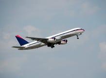 Boeing 757 passenger jet. Modern jet airplane in flight approaching airport Stock Photos