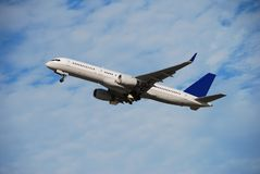 Boeing 757 passenger jet. Modern jet airplane taking off royalty free stock photography