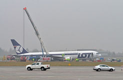Boeing 767. Preparing to move a Boeing 767 of Polish LOT airlines to unblock one of the airport's two runways and allow for air traffic on November 2, 2011 Stock Photography