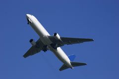 Boeing 767 climbing away royalty free stock photo