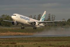 Boeing 767 Take off. An euroAtlantic Boeing 767 takes off in a wet morning. euroAtlantic, as descrived in their site,  is specialized in aircraft leasing for Royalty Free Stock Image