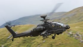 Boeing AH-64 Apache. An Army Air Corp AH-64 Apache on a low level training sortie through Wales stock images