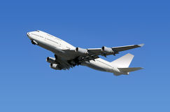 Boeing Airplane. Boeing 747 airliner taking off under a blue clean sky Royalty Free Stock Image