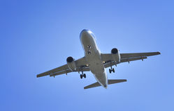 Boeing Airplane. Flying in blue sky stock photography