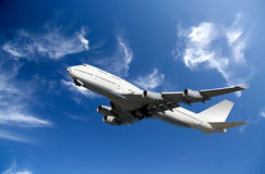 Boeing Airplane. White Boeing 747 Airplane taking off on a background blue clean sky Royalty Free Stock Photos