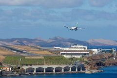 Boeing 737 is approaching Funchal Airport at Madeira, Portugal Royalty Free Stock Photos