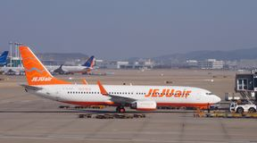 A Boeing 737-8AS airplane from Korean low-cost airline Jeju Air 7C. INCHEON, SOUTH KOREA -A Boeing 737-8AS airplane from Korean low-cost airline Jeju Air 7C on stock photos