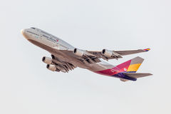 Boeing 747-800 of the Asiana Airlines. FRANKFURT, GERMANY - JULY 17: Boeing 747-800 of the South Korean Asiana Airlines after take off at the Frankfurt Stock Photo