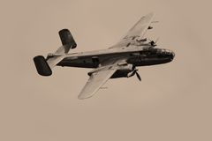 Boeing B-25. Old sepia photo of a Boeing B-25 airplane in mid air Stock Photography