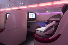 A380 Boeing Business Class plane interior. Pink interior of the business class section in the A380 Boeing Airliner in Dubai Airport, United Arab Emirates 2016 royalty free stock image