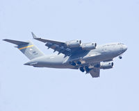 The Boeing C-17 Globemaster III military aircraft  flying at Aero India Show 2013. Stock Photos