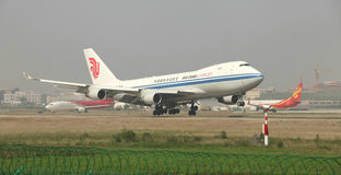 A boeing 747 cargo landing on the runway. A air China airlines boeing 747 cargo landing at Zhengzhou Airport royalty free stock images