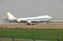 A boeing 747 cargo landing on the runway Stock Images