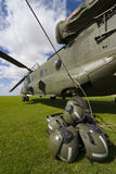 Boeing CH-47 Chinook. A Boeing CH-47 Chinook with the rotor blades all tied down and the crew's helmets in the foreground Royalty Free Stock Image