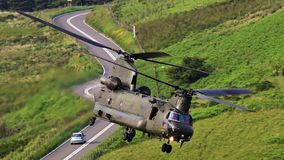 Boeing CH-47F Chinook transport helicopter in flight stock photo