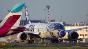 Boeing 787-9 Dreamliner Star Wars R2-D2 Livery on taxiway stock footage