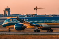 Boeing 787-9 Dreamliner Vietnam Airlines on sunset. Boeing 787-9 Dreamliner Vietnam Airlines landing at Moscow airport Domodedovo on sunset Stock Photo