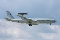 Boeing E-3A Sentry AWACS. NATO Boeing E-3A Sentry AWACS in landing configuration at final approach. Huge radar antenna over the fuselage Royalty Free Stock Images