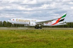 Boeing 777 of Emirates airlines is landing at airport Pulkovo Stock Image