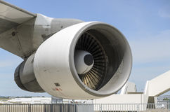 Boeing Engine. Vivid image of a jumbo jet engine and wing set against a perfect blue sky Royalty Free Stock Photography