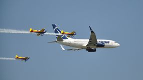 Boeing 737 and Extra 300L Royalty Free Stock Photography