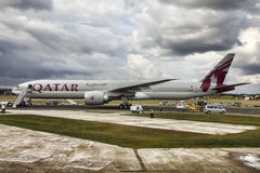 Qatar Airways Boeing 777. A Qatar Airways Boeing 777 on display at the Farnborough Air Show with its doors open for visitors royalty free stock images