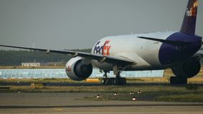 Boeing 777-FHT of FedEX turn to the airport terminal