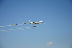 Boeing 737 flanked by four airplanes. During air show in Bucharest, Romania stock images