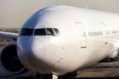 Boeing 777. Front view of a Boeing 777, no logo Stock Photo