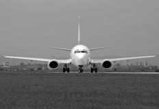 Boeing in greyscale. Boeing aircraft turning on the runway Royalty Free Stock Image