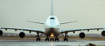Boeing 747 jet airliner on runway. Boeing 747 jumbo jet jet airliner on runway - front view Stock Image