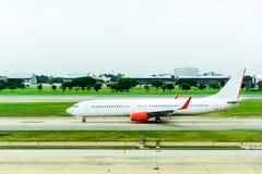 Boeing 737 landing at runway Stock Images