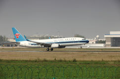 A boeing 737 landing on the runway Stock Image