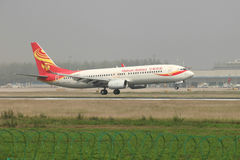 A boeing 737 landing on the runway. A Hainan airlines boeing 737 landing at Zhengzhou Airport royalty free stock photo