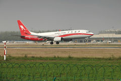 A boeing 737 landing on the runway. A Shanghai airlines boeing 737 landing at Zhengzhou Airport stock images