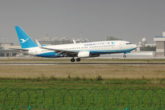 A boeing 737 landing on the runway. A Xiamen airlines boeing 737 landing at Zhengzhou Airport royalty free stock photo