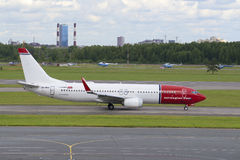 The Boeing 737-800 (LN-NHB) Norwegian Air Shuttle on the runway at Pulkovo airport. St. Petersburg Stock Photos