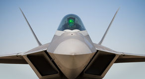 Boeing/Lockheed F-22 Raptor. A Boeing/Lockheed F-22 Raptor against a blue sky Stock Photo