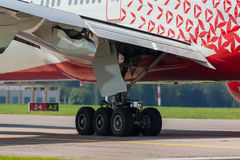 Boeing 747 moves on the runway Stock Images