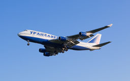 The Boeing-747 plane of Transaero airline comes in the land at the Sheremetyevo airport Stock Photography