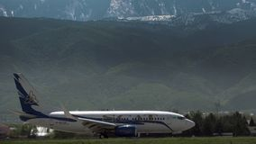 Boeing 737 of SCAT airlines. Scenery landscape with mountains stock video