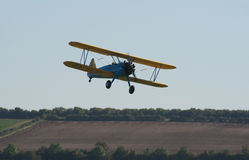 Boeing Stearman biplane flies low Stock Images