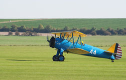 Boeing Stearman biplane taxis after landing Royalty Free Stock Photography